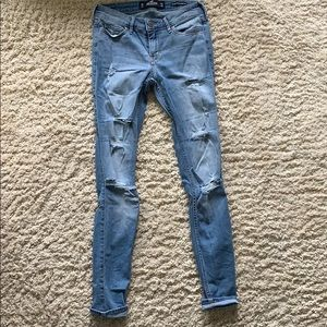 Distressed faded wash skinny jeans